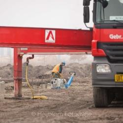 Heijblom-Fotografie-Bouwfotografie-bouwvakker-egaliseert