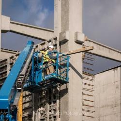 Heijblom-Fotografie-Bouwfotografie-bouwvakker-in-hoogwerker-aan-het-werk