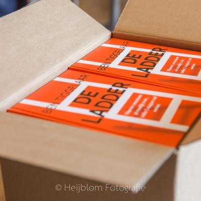HEIJBLOM FOTOGRAFIE-evenementenfotografie-Fit-for-Work-Amersfoort-doos-met-boeken-de-ladder
