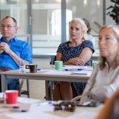 HEIJBLOM FOTOGRAFIE-evenementenfotografie-Fit-for-Work-Amersfoort-luistershot-van-de-zaal-tijdens-presentatie-Ben-Tiggelaar