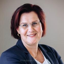 Portret voor LinkedIn dame met een blauw colbert